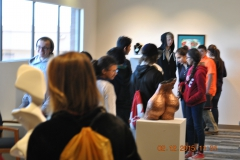 Eighth grade students on a Verde Valley campus tour, in the art gallery.