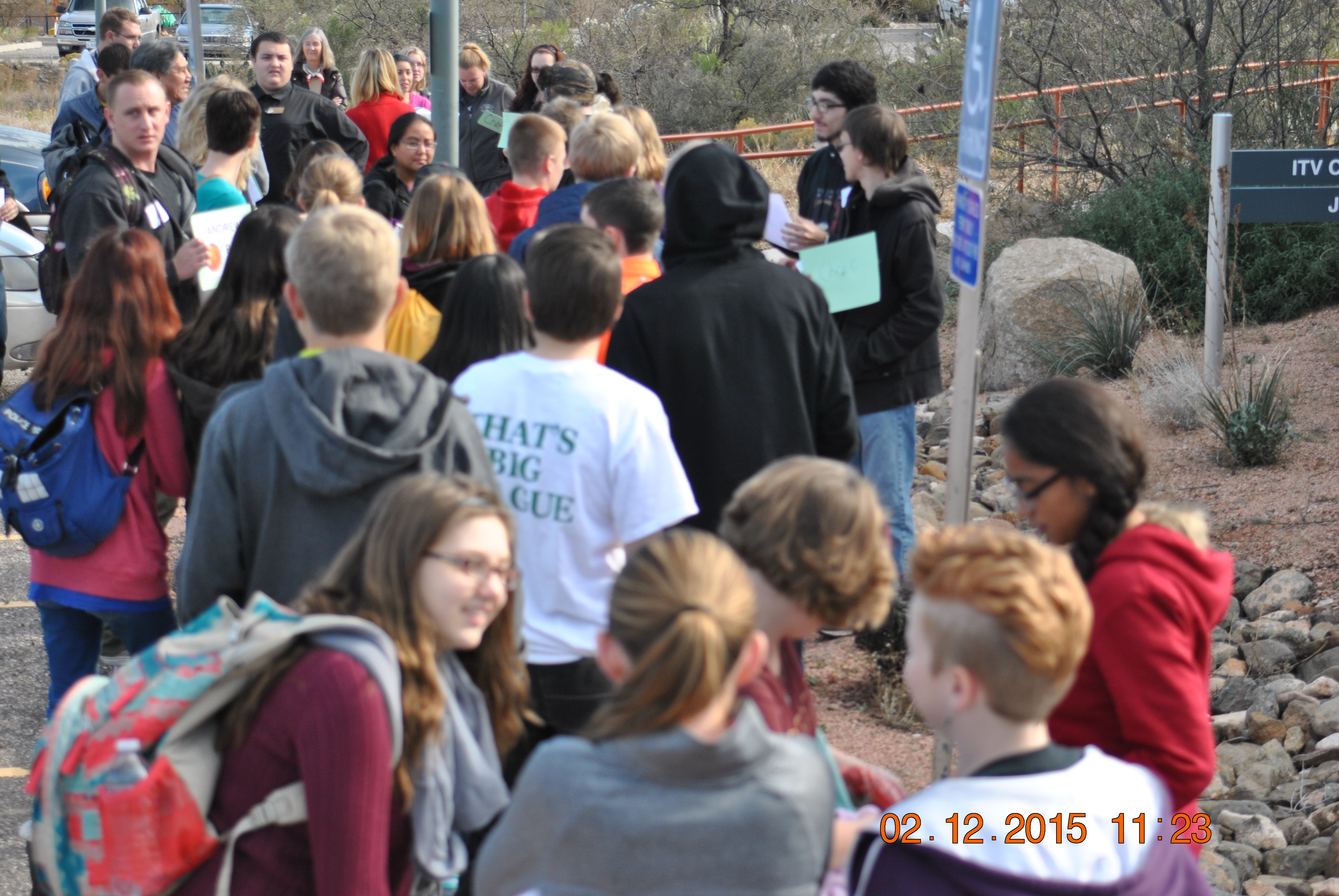 Eighth grade students arrive to greet college students.